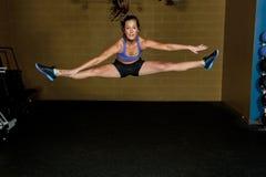 Girl Doing Jump Split Stock Images