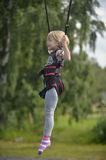 A girl is doing jumping on the jumping attraction. Stock Photography