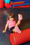 Girl doing kids gymnastics in gym stock image