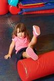 Girl doing kids gymnastics in gym Stock Image
