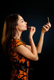 Girl doing make-up Stock Images