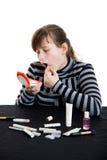Girl doing make-up Stock Photo