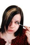 Girl doing makeup. Stock Photography