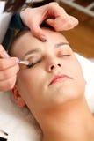 Girl doing makeup Royalty Free Stock Image