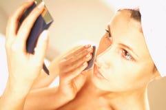 Girl doing makeup. Close up stock photo