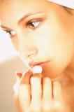 Girl doing makeup. Close up stock images