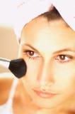 Girl doing makeup. Close up Stock Photos