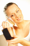 Girl doing makeup. Close up royalty free stock image