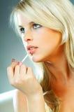 Girl doing makeup Stock Photo