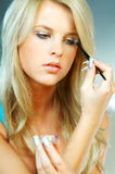 Girl doing makeup Royalty Free Stock Photos