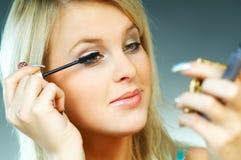Girl doing makeup Royalty Free Stock Photography