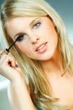 Girl doing makeup royalty free stock photos