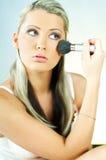 Girl doing makeup Royalty Free Stock Photo