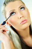 Girl doing makeup Royalty Free Stock Image