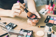 Girl doing makeup on dressing table Royalty Free Stock Photos