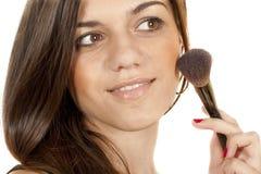 Girl doing makeup face Stock Image
