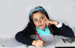 Girl doing maths homework. Concentrated teenager girl sitting at her desk  doing her maths school  homework Royalty Free Stock Images