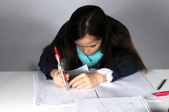 Girl doing maths homework. Concentrated teenager girl sitting at her desk  doing her maths school  homework Stock Photography