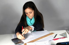 Girl doing maths homework. Concentrated teenager girl sitting at her desk  doing her maths school  homework Royalty Free Stock Photography