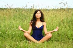 Girl doing meditation Royalty Free Stock Image