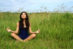 Girl doing meditation Royalty Free Stock Photography
