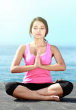 Girl doing meditation on the beach Royalty Free Stock Image