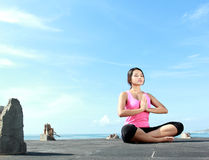 Girl doing meditation in the morning Stock Photo