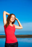 Girl doing morning exercises at the beach Royalty Free Stock Photo