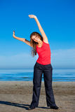 Girl doing morning exercises at the beach Royalty Free Stock Photography