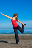 Girl doing morning exercises at the beach Royalty Free Stock Photos