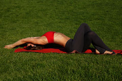 Girl doing morning exercises. yoga. Woman practices yoga in nature Royalty Free Stock Photography