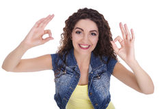 Girl doing ok. Beautiful Caucasian woman. She makes a gesture with his hand. Emotionally smiling, everything is OK. The white background isolated Royalty Free Stock Photography