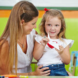 Girl doing paper origami Royalty Free Stock Photo