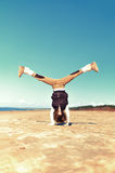 Girl is doing perfect handstand on the beach Royalty Free Stock Photo