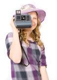Girl doing photo polaroid camera. Teenage girl doing photo polaroid camera Royalty Free Stock Photography