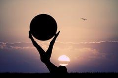 Girl doing pilates at dawn Stock Image