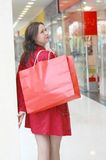 The girl doing purchase in shopping centre Stock Photo