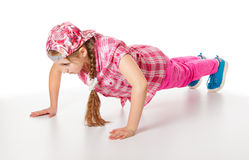 Girl doing push-ups. Isolated on a white background Royalty Free Stock Photography