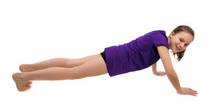 Girl doing push ups Royalty Free Stock Image