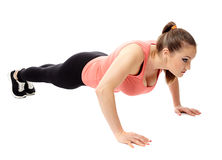 Girl doing pushups Royalty Free Stock Photos