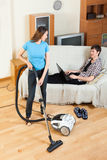 Girl doing room cleaning with vaccuum cleaner Stock Photo