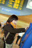 Girl doing self-checkin in the airport Stock Images