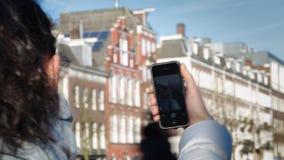 Girl doing selfie phone. In Amsterdam stock footage