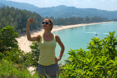Girl doing selfie on tropical beach background Royalty Free Stock Images