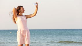 Girl doing selfie with your phone stock footage
