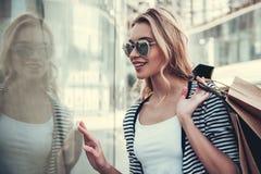 Girl doing shopping stock image