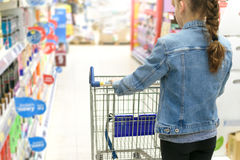 Girl doing shopping in a supermarket Royalty Free Stock Image