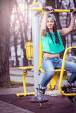 Girl doing shoulder press outdoor Stock Photography