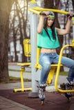 Girl doing shoulder press outdoor Stock Photo