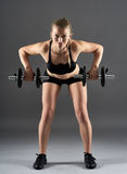 Girl doing shoulder workout with dumbbells Stock Photography